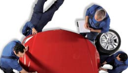 top view of mechanics servicing a red car